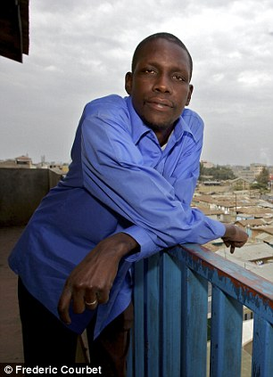 George Hussein Obama in Nairobi: The half brother of Barack Obama has agreed to appear in a documentary which is critical of the U.S. President