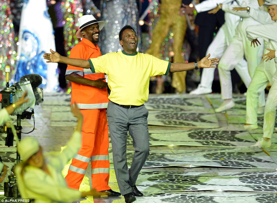 Football superstar: Pele appears on stage, wearing Brazilian colours, for a performance with former street cleaner Renato Sorriso