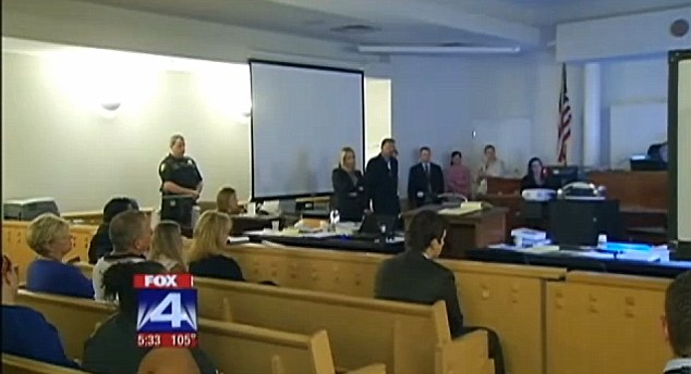 Uncomfortable viewing: The courtroom watches the video footage which reportedly shows Colleps having sex with four students