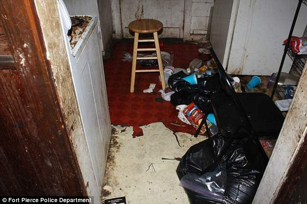 Grim: Officers said there was so much rubbish on the floor they were unable to walk through the house
