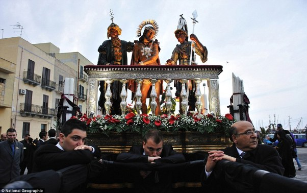 During the Easter holy celebration called iMisterii in Trapani, the devotees carry the scenes of Christ's passion on their shoulders all night long, only when the day comes do they take a break