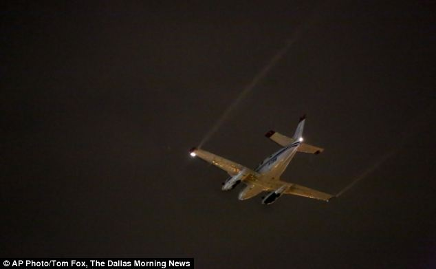 Battle: An aircraft sprays insecticide over part of Dallas County