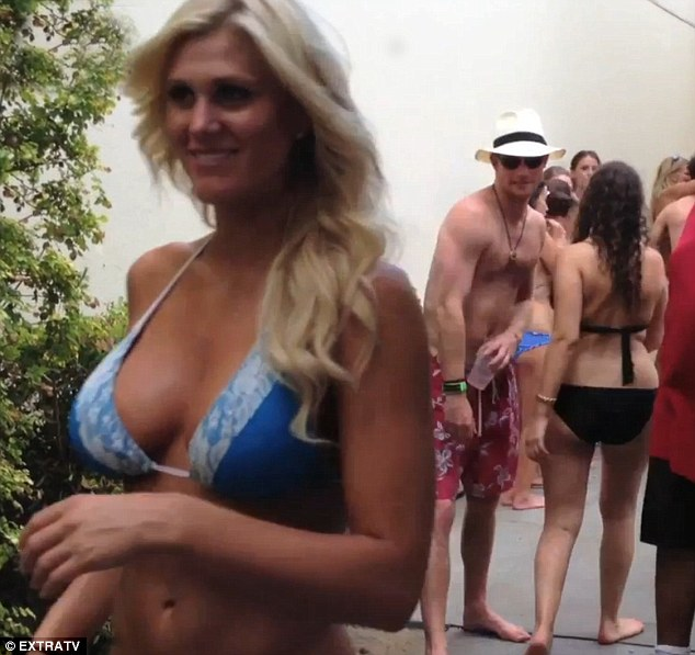 Centre of attention: Prince Harry casts a lingering glance in the direction of the stunning blonde as he enjoys himself during a pool party in Las Vegas