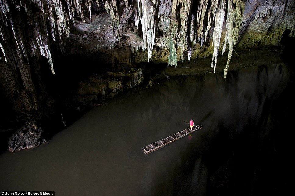 Shan Man Ong, standing on the bamboo raft explores the downstream entrance of Tham Lod cave in Pang Mapha, Thailand