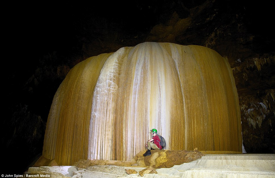 Dave Pierce examines the flowstone at Tham Pha Mon cave in Pang Mapha, Thailand