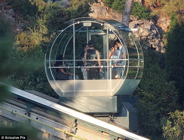 Great glass elevator: The group took a see-through lift to get up the steep and high cliff face