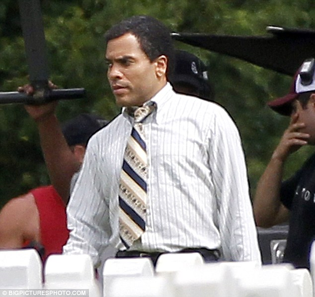 Suits you: Lenny Kravitz was also seen on set in Louisiana today