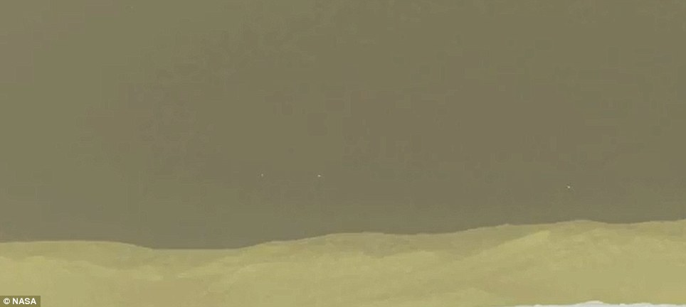 The Martian landscape: But what is that hovering over the background? Dots appear to float in the sky, leading some observers to suggest an alien presence