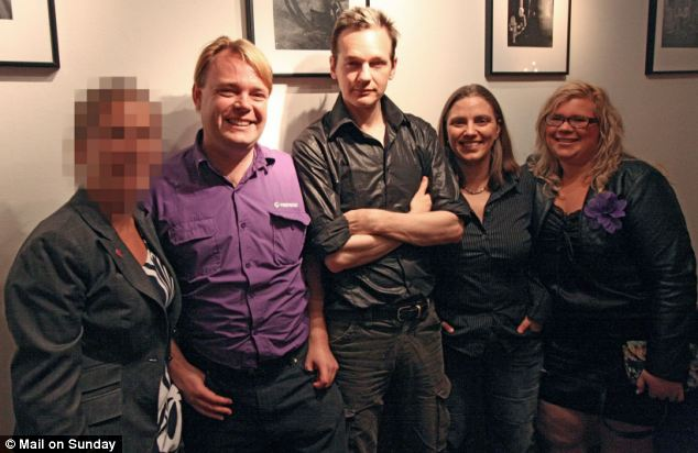 Smiles all around: Woman A, left, at a dinner with Julian Assange, centre, host Richard Falkvinge, Anna Troberg and Sara Sangberg