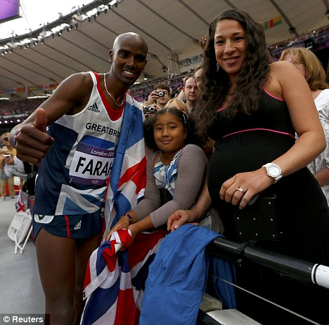 Happy family: Mo Farah with his stepdaughter Rhianna and then pregnant wife Tania after securing 5,000m Olympic gold