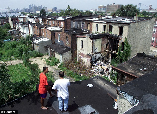 Run-down: Residents look out over the gutter city where almost half of people are unemployed