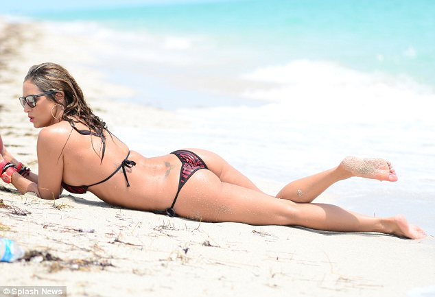 Not all working out and no play: The fitness fanatic also squeezed in a spot of sunbathing on the sand