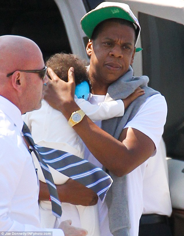 Protective: Jay-Z kept his gorgeous girl close