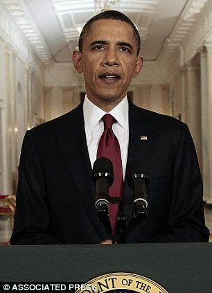 President Barack Obama reads his statement to photographers after making a televised statement on the death of Osama bin Laden
