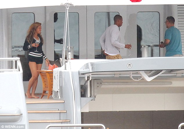 Casual chic: Beyoncé wore a navy and white cricket-style jumper and a pair of matching shorts
