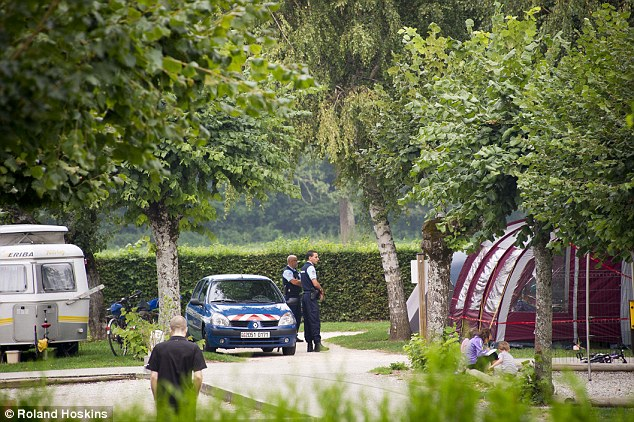 Making enquries: French investigators had begun inspecting Le Solitaire du Lac campsite at Saint-Jorioz, where the murdered family are believed to have been staying