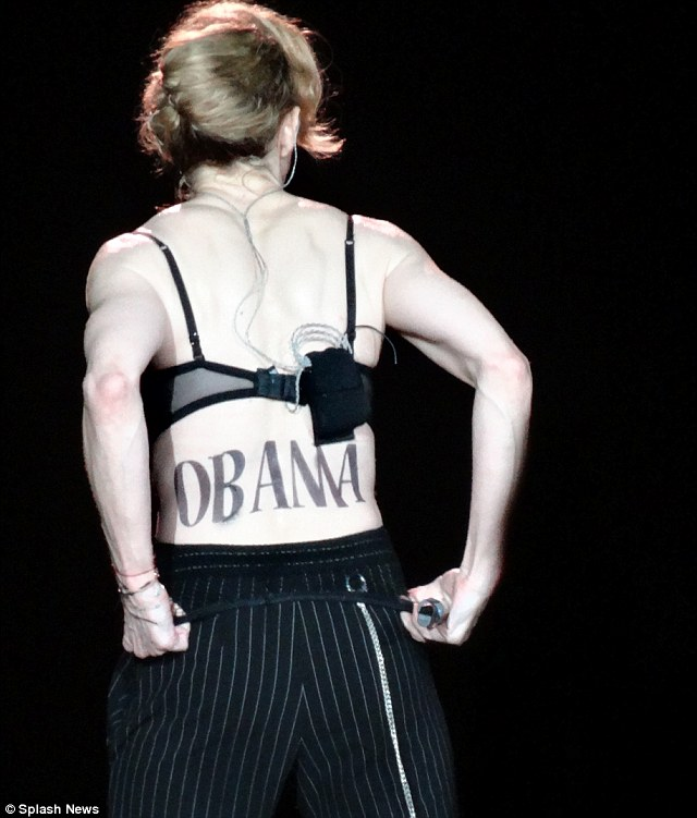 Surprise endorsement: Madonna 'backs' Obama with a temporary tattoo during her MDNA Tour at the New York's Yankee Stadium