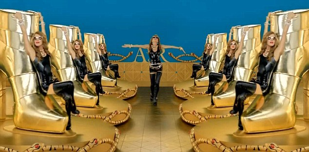 Those boots are made for walking: The fashionista dances on a giant gold replica of a shoe that is part of her range