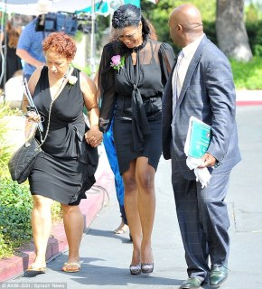 Saying goodbye: Michael Clarke Duncan's fiancé Omarosa Manigault-Stallworth is supported as she arrives at the Hall of Liberty in Hollywood for his funeral
