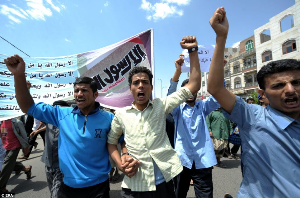 Marching: Yemeni men shout slogans during a protest