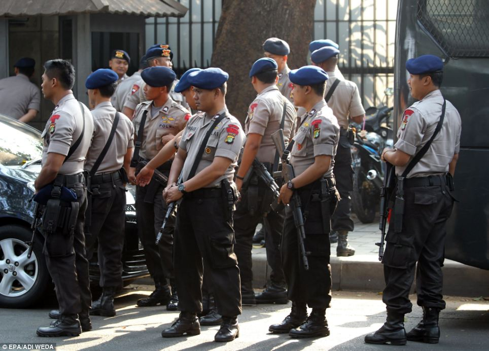 Alert: Indonesian riot police stand guard outside the U.S. ambassador's residence in Jakarta in anticipation of Muslim protests over the film