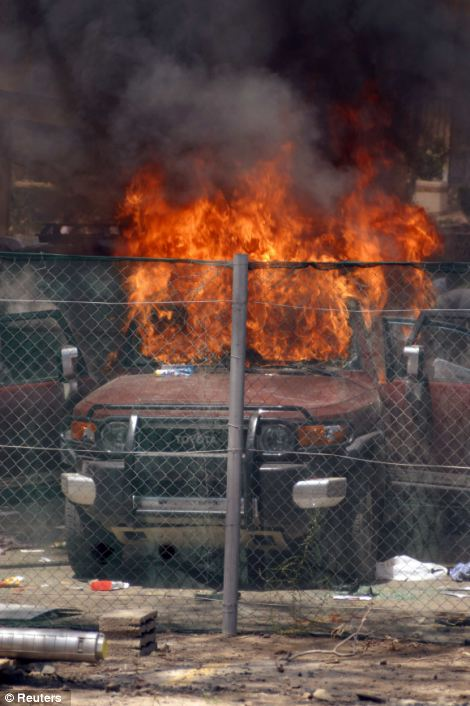 A burning vehicle outside the embassy