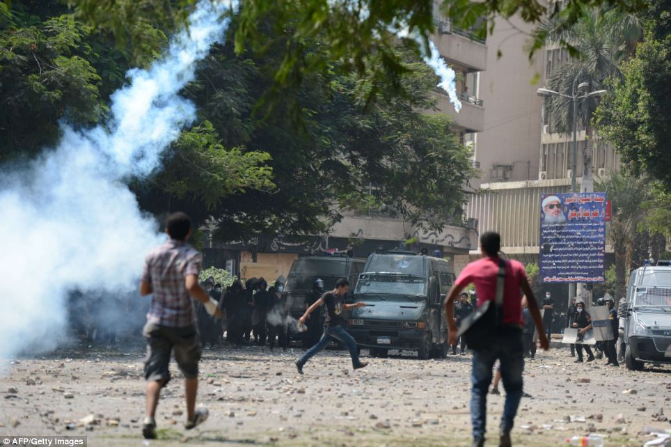 Tear gas: Riot police used canisters of tear gas to try and disperse the protestors in Cairo