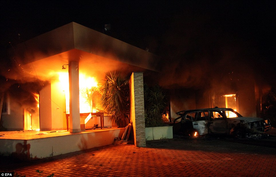 Set ablaze: Explosions erupted throughout the embassy on Tuesday night, and an official vehicle can already be seen scorched and destroyed
