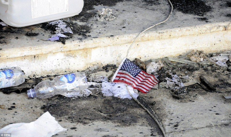 Old Glory: A US flag is seen amid the rubble at the US consulate amid other debris