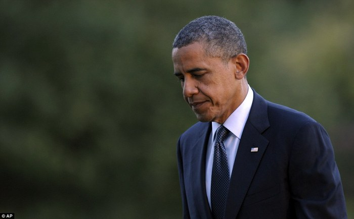 Strong words: President Obama, seen walking from Marine One on the South Lawn of the White House Thursday, said at a campaign event today 'No act of terror will go unpunished'