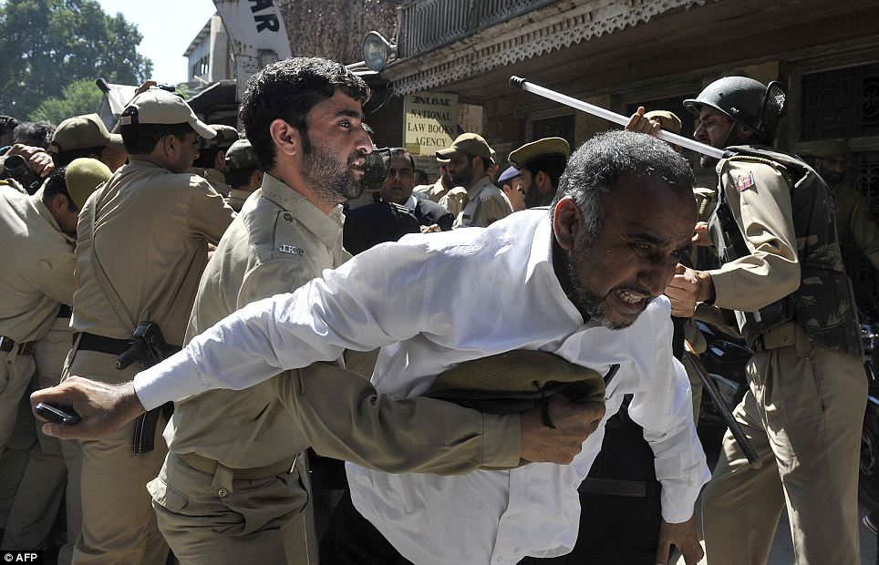 Unrest: Police try to stop Kashmiri lawyers during a demonstration against the controversial film