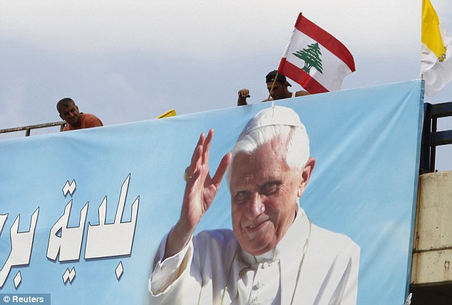 Celebration: Groups of different faiths have erected banners to welcome the Pope, including this one at the main airport road in Beirut