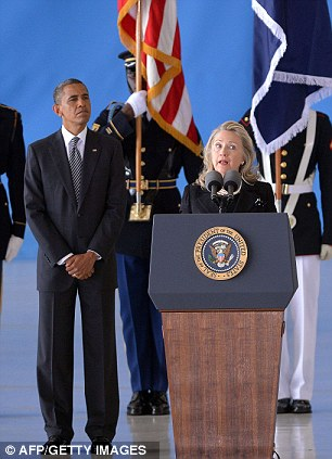 US President Barack Obama listens as Secretary of State Hillary Clinton speaks during the transfer of remains ceremony marking the return to the US of the remains of the four Americans killed in an attack this week in Benghazi, Libya