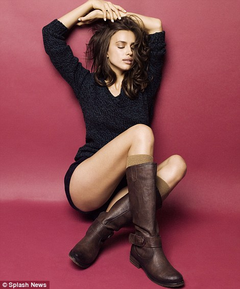 The thighs the limit: The model showcases some winter boots and at the same time shows off her slender thighs