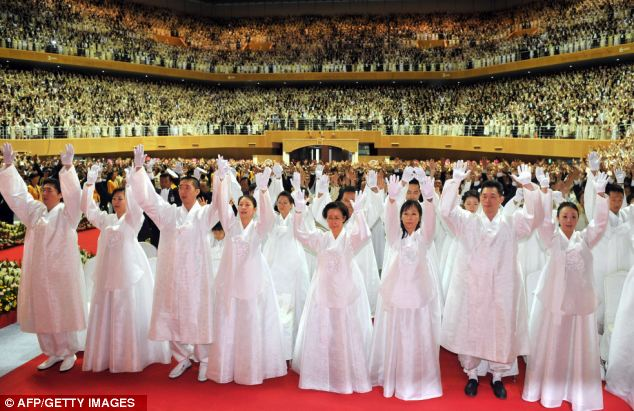 Followers: Critics for years have vilified the church as a heretical and dangerous cult and questioned its murky finances and how it indoctrinates followers, described in derogatory terms as 'Moonies'