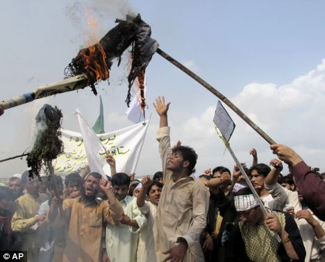 'Death to America': Afghans burn an effigy of President Obama during a protest in Khost, south-east of Kabul