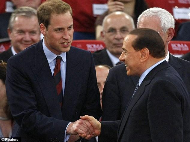 Former Italian Prime Minister Silvio Berlusconi shakes hands with Britain's Prince William