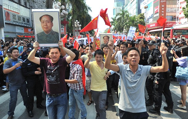 Protesters march during an anti-Japan protest in Shenzhen in south China's Guangdong province yesterday