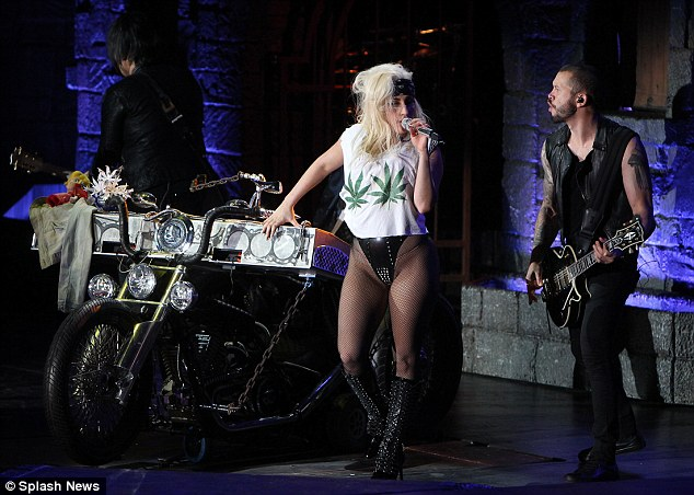 Musical support: The singer was joined on stage by her band, who appeared thoroughly engrossed in the performance