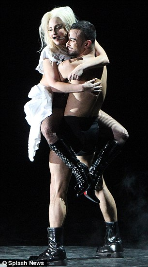 Cuddling up: Gaga seemed very friendly with one male dancer in particular