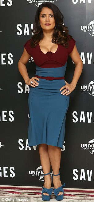 Showstopping: Hayek showed off her killer curves in a form-fitting aubergine and teal dress
