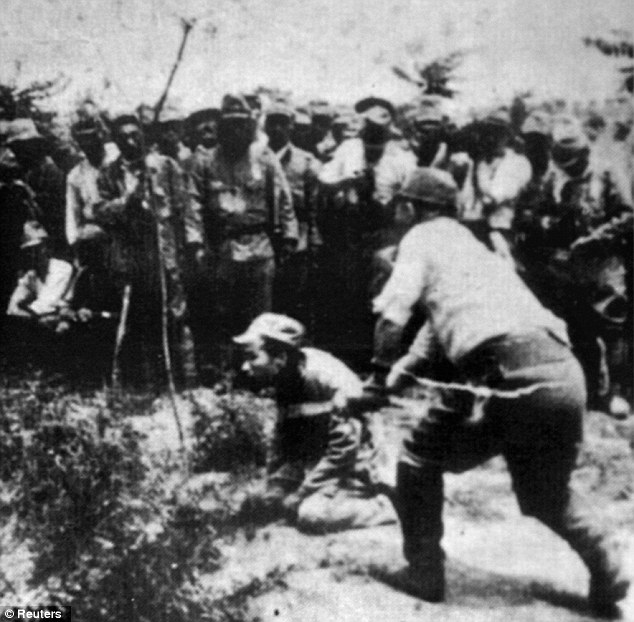 Merciless: A Japanese soldier beheads a Chinese prisoner
