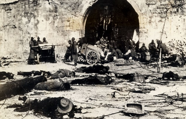 The rape of Nanking: Chinese dead litter the street after Japanese forces stormed the city in 1937