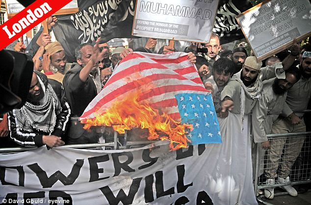 Peaceful turned fiery: Even the demonstration outside the American embassy in London was combustible