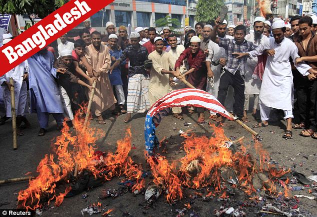 Fire starter: Protestors in Bangladesh targeted the American flag, as was seen in the demonstrations across the globe