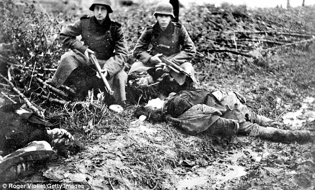 Tainted: German soldiers crouch over the bodies of two shot down civilians