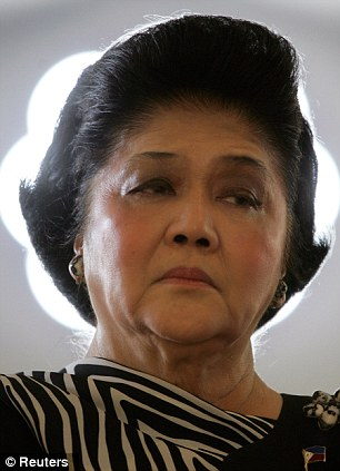 Shoe trouble: Part of Imelda Marcos' shoe collection, left behind after she and her dictator husband were driven out of the Philippines, has been badly damaged by termites, floods and general neglect