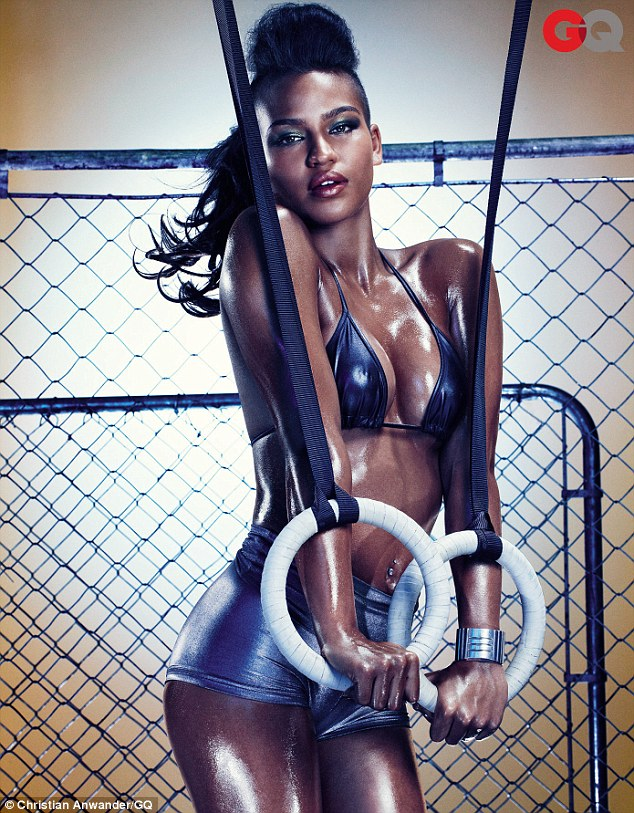 Oiled up: Singer Cassie makes a shiny appearance in GQ magazine's October issue