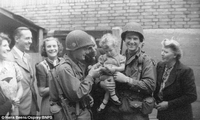American soldiers of the 101st Airbourne Division celebrate with the local children in Eindhoven