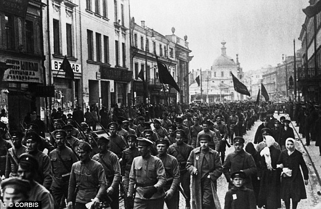 Odd choice: Parents and historians agreed it was shocking to commemorate an event that led to Communism and the deaths of millions. Pictured, soldiers march in 1917